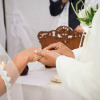 placing the ring on her finger